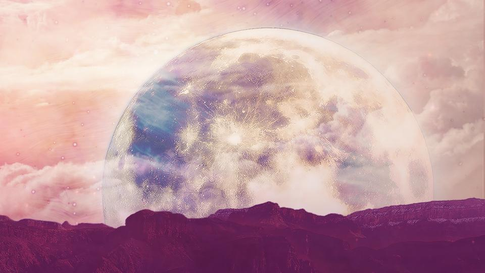 Picture of large moon rising over purple desert with pink sky