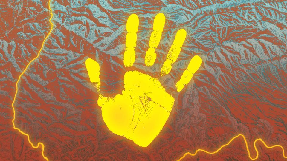 A glowing yellow handprint on a topographic background